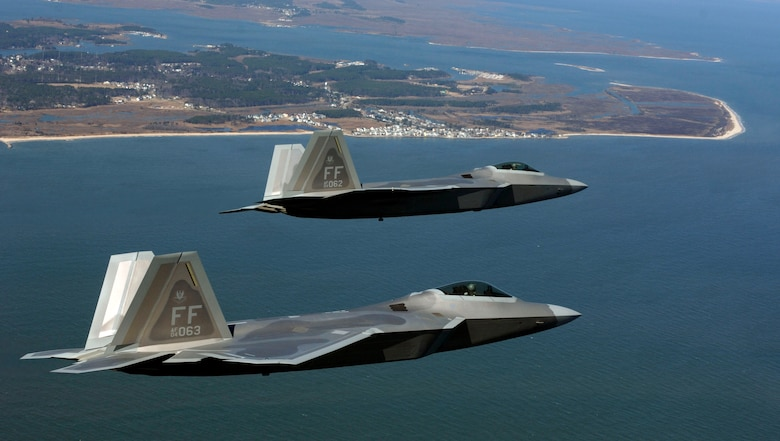 Two F-22 Raptors move into the Langley Air Force Base pattern over Virginia. A squadron of F-22 Raptors is scheduled to deploy to Kadena Air Base, Japan, as part of U.S. Pacific Command's Theater Security Package in the Western Pacific in early 2007. This will be the first overseas deployment for the Air Force's newest fighter. (U.S. Air Force photo/Tech. Sgt. Ben Bloker)