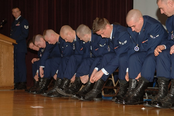 Recent graduates of the Survival, Evasion, Resistance and Escape school blouse their blues pants over their boots as a tradition upon graduation. In this particular class, 66 students made began, but only 33 made it out. A graduation certificate, sage beret, and appreciation letter were delivered personally by Congresswoman Cathy McMorris.
