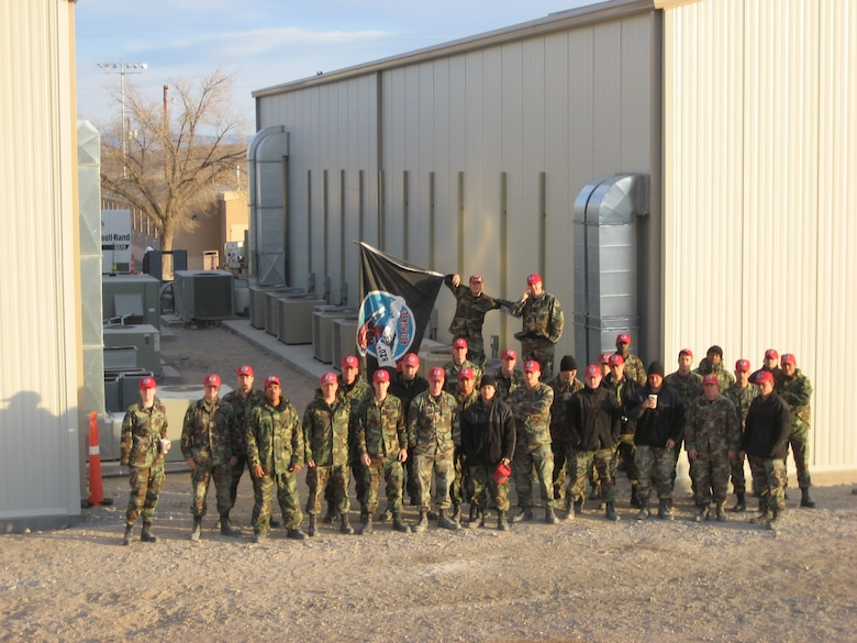 The multi-crafted team of REDHORSE Airmen pose for a group picture outside their recently constructed facilities for the 42nd Attack Squadron and 11th Reconnaissance Squadron at Creech. U.S. Air Force photo by Capt. Steve Thomas / 820th REDHORSE
