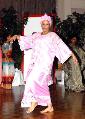 """Shawn Crocker, a model at """"History of Fashion ... A Night to Remember,"""" showcases historical African wear during the """"Deeply Rooted in Fashion"""" segment of the fashion show Jan. 5 at the Gateway Club. More than 135 people attended the show sponsored by the 2007 African-American Heritage Committee. Proceeds raised from the fashion show go to the African-American Heritage scholarship fund. (USAF photo by Alan Boedeker)"""