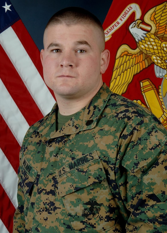 Marine Corps Staff Sgt. Richard T. Molnar from Company A, Marine Cryptologic Support Battalion is Team Buckley's Star Performer for the week of Jan. 12 - 18.