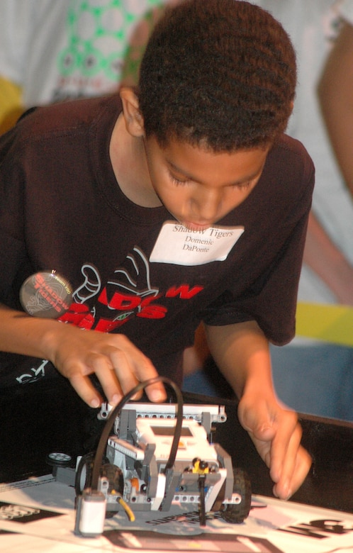 Domenic Daponte of the Shadow Tigers from Marietta resets his robot during first-round competition at the For Inspiration and Recognition of Science and Technology Regional Lego League Robotics competition.   U.S. Air Force photo by Sue Sapp.