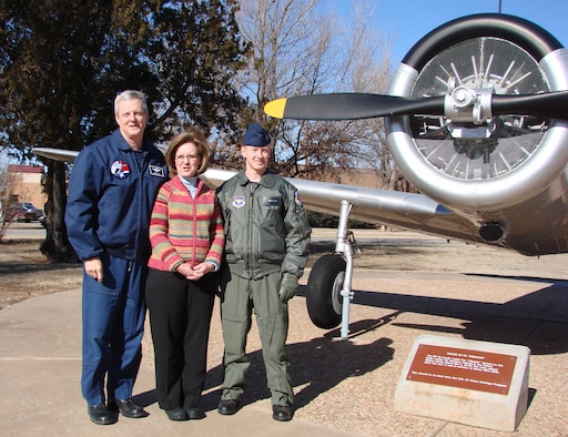 Second Lt. Timothy Cox, right, Class 08-03 Joint Specialized Undergraduate Pilot Training, poses with his parents, retired Lt. Col. Terry and Cheri Cox in front of BT-13, one of more 50 aircraft flown by his grandfather and Mrs. Cox's father, the late retired Maj. Gen. Robert Rushworth. Upon graduation from training, Lt. Cox will extend the family's legacy as a third generation pilot.  USAF photo by Frank McIntyre