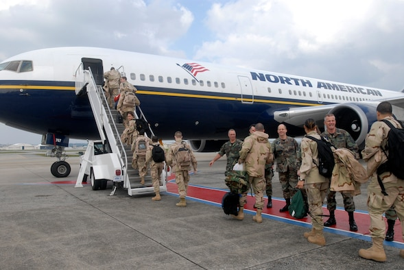 Airmen from Kadena Air Base, Japan, embark Jan. 8 on a commercial aircraft for transport to support the war on terrorism. More than 600 Kadena members are deploying to various locations in the U.S. Central Command's area of responsibility. (U.S. Air Force photo/Airman 1st Class Sheila deVera)