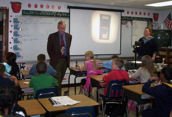 Congressman Vic Snyder visits with Cheri Dunlap's fifth grade students at Arnold Elementary School recently to see the base's school facilities first-hand. Arnold Elementary School, while boasting among the highest test scores in the state, is in need of some repairs. (Courtesy photo)