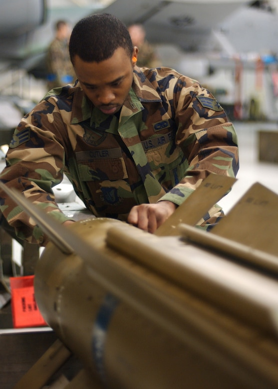 EIELSON AIR FORCE BASE, Alaska -- Senior Airman Corneilius Cutler, 18th Aircraft Maintenance Unit, 354th Aircraft Maintenance Squadron prepares the Air to Ground Missile 65 D Bomb to be loaded onto an F-16 Fighting Falcon during the Weapons Standardization Load Crew of the Year Competition hereon Jan. 11. The Competition evaluates technical proficiency, safety procedures and overall time. The 18th AMU's overall time was 56 minutes and 37 seconds.  