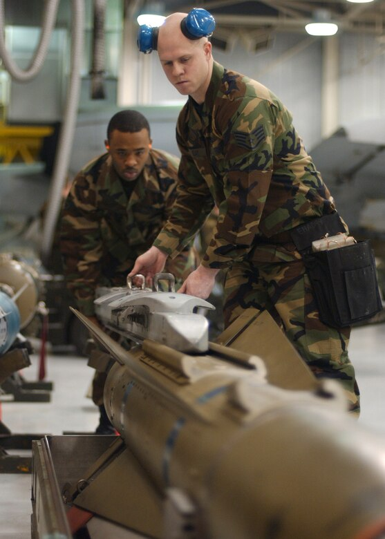 EIELSON AIR FORCE BASE, Alaska -- Staff Sgt. Aaron Slay (right) and Senior Airman Corneilius Cutler, 18th Aircraft Maintenance Unit, 354th Aircraft Maintenance Squadron slides a LAU-117 into place on top the Air to Ground Missile 65 D Bomb to be loaded onto an F-16 Fighting Falcon during the Weapons Standardization Load Crew of the Year Competition here on Jan. 11. The Competition evaluates technical proficiency, safety procedures and overall time. The 18th AMU's overall time was 56 minutes and 37 seconds.  