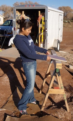 1st Lt. Sandra Martinez, 49th Comptroller Squadron, readies a tile before it's installed into a home the CGOC is helping build with Habitat for Humanity. The home is in Tularosa and is scheduled to be completed by the end of February.