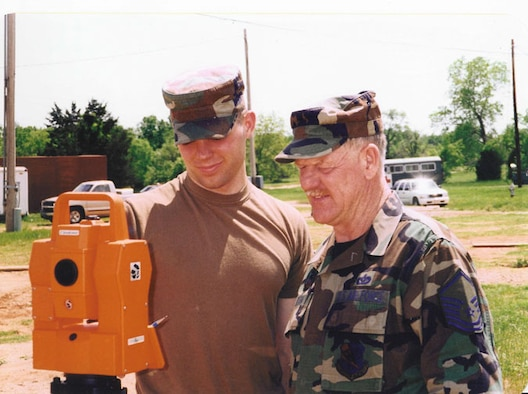 Master Sergeant William Dean, right, instructs a fellow civil engineer during a training exercise off base.