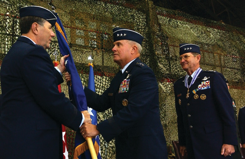 OSAN AIR BASE, Republic of Korea --  Gen. Paul V. Hester, Pacific Air Force Command commander, hands the 7th Air Force guidon to Lt. Gen. Stephen G. Wood, the new 7th Air Force commander, as Lt. Gen. Garry R. Trexler, the former commander, looks on Monday in the 5th Reconnaissance Squadron Blackcat hangar. Lt. Gen. Trexler is retiring after a 36 year career in the Air Force. (U.S. Air Force photo by Senior Airman Eunique Stevens)