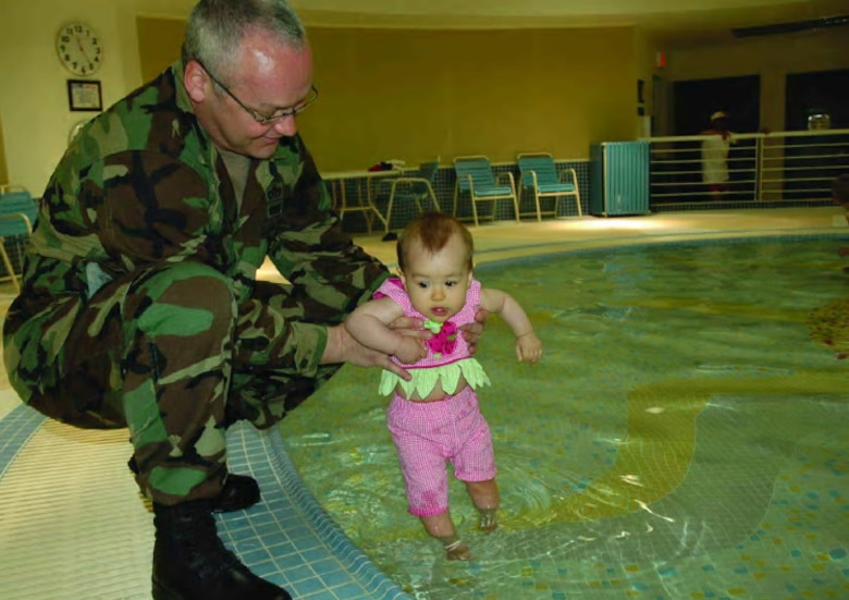 OSAN AIR BASE, Republic of Korea --  Col. Shane Stegman, 51st Mission Support Group deputy commander, and daughter Ellie, 9 months, were the first people to take a dip in Osan's new indoor wading pool May 22. (U.S. Air Force photo by Staff Sgt. Andrea Knudson)