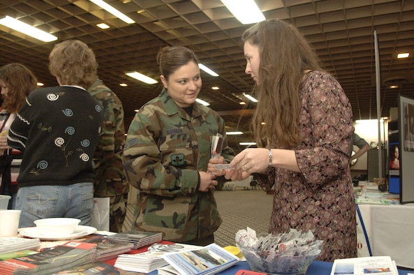Senior Airman Tara Norman, 336th Training Support Squadron, accepts base information from Melissa Still of the Airman and Family Readiness Center at the Right Start seminar Jan. 12. Airman Norman arrived at Fairchild Nov. 4 from Kirtland Air Force Base, N.M.