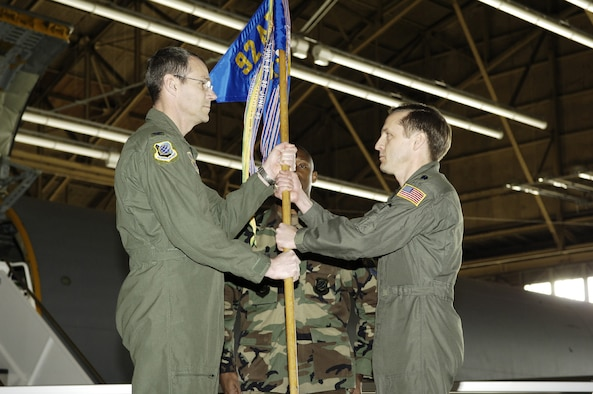 Col. Mark Melville, 92nd Operations Group commander, passes the guidon to Lt. Col. John DeLapp, 92nd Air Refueling Squadron commander, in a change of command ceremony Jan. 12. Colonel DeLapp moved to the 92nd ARS from the Wing Safety Office.