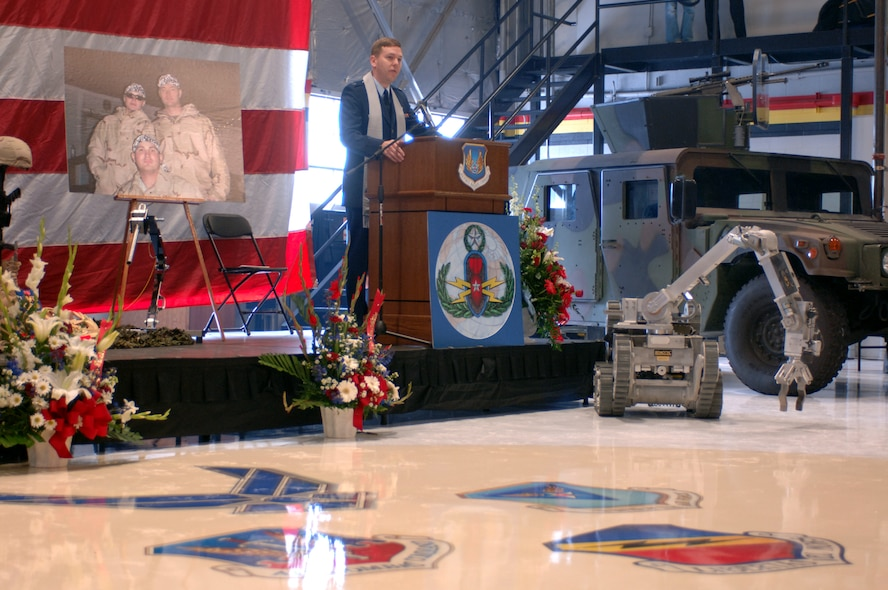 Chaplain Capt Alex F. Jack paid tribute during a memorial service to the fallen comrades at Hill Air Force Base who were killed-in-action in Iraq earlier this week as a result of a car bomb. The three Airmen killed are Tech Sergeant Timothy R. Weiner, Senior Airman Elizabeth A. Loncki and Senior Airman Daniel B. Miller, Jr.