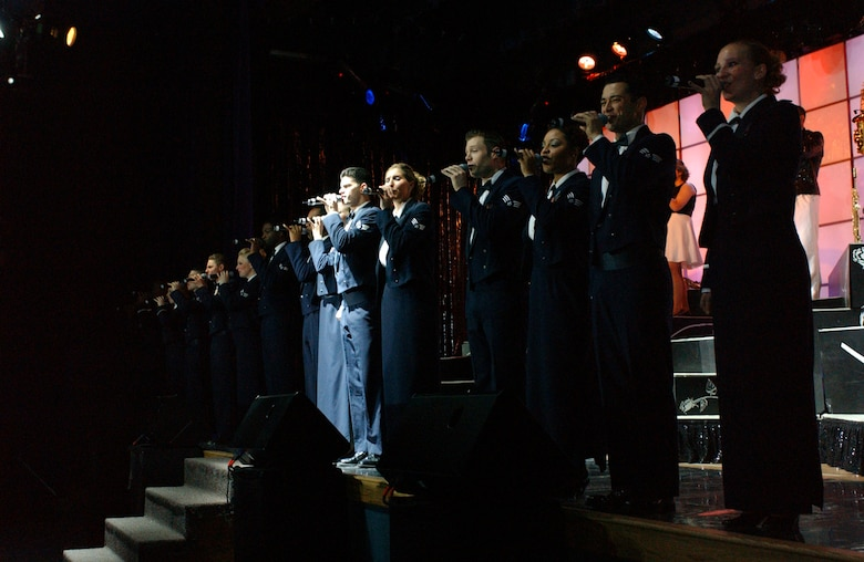 """EIELSON AIR FORCE BASE, Alaska --The Tops in Blue world tour 2006 performs """"what's love?"""" in Eielson AFB's Theatre on Jan. 12.  Their performance ushers in lively show tunes, country love, old time favorites, and today's hits in a classic fashion. The Air Force's Expeditionary Entertainers evoke one to reminise the power of love for family, their country, and that 'special someone'. (U.S. Air Force photo by Senior Airman Rachel Walters)"""