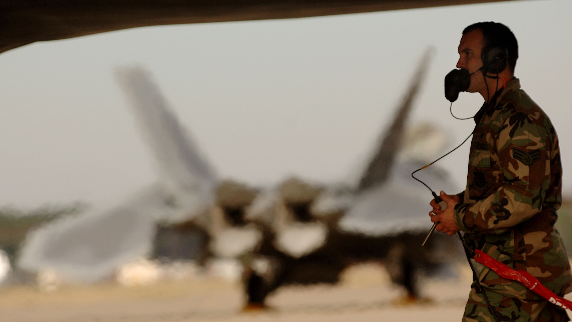 Senior Airman Joseph Vanord, a dedicated crew chief with the 94th Fighter Squadron at Langley Air Force Base in Virginia, begins shut downs procedures on a F-22A Raptor piloted by 1st Fighter Wing Commander Brig. Gen. Burton Field on Jan. 19, 2007. General Field's delivery of the 40th F-22A Raptor from the factory at Lockheed Martin in Marietta, Ga., to the 1st Fighter Wing at Langley AFB marks the completion of delivery from factory to the installation. (USAF Photo by Staff Sgt Samuel Rogers)