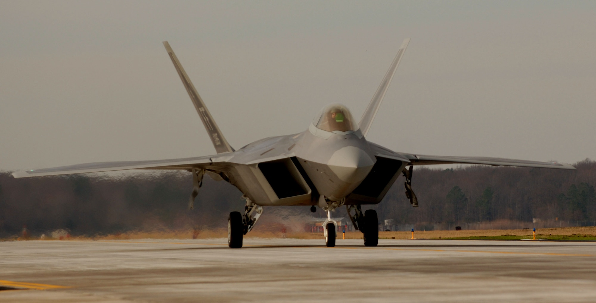 1st Fighter Wing Commander Brig. Gen. Burton Field, taxi's down the runway in the 40th F-22A Raptor delivered  from the factory at Lockheed Martin in Marietta, Ga., to the 1st Fighter Wing at Langley AFB in Virginia on Jan. 19, 2007. The delivery of this mighty aircraft marks the completion of delivery from the factory to the installation. (USAF Photo by Staff Sgt Samuel Rogers)