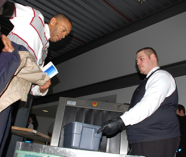 A passenger empties his pockets on his way through a newly located security checkpoint at the Ramstein Passenger Terminal Jan. 18 at Ramstein Air Base, Germany. The metal detectors and carry-on baggage screening devices used to be at the front door of the terminal that caused long waits. The change is part of an Air Force Smart Operations for the 21st century initiative. (U.S. Air Force photo/Staff Sgt. Dan Bellis)