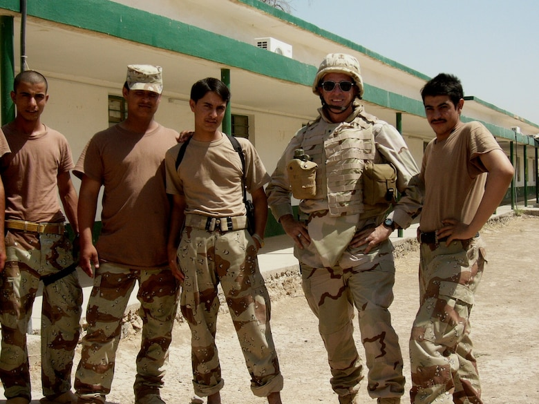 Lt. Col. Fulton poses for a photo with Iraqi soldiers during his deployment to Iraq.
