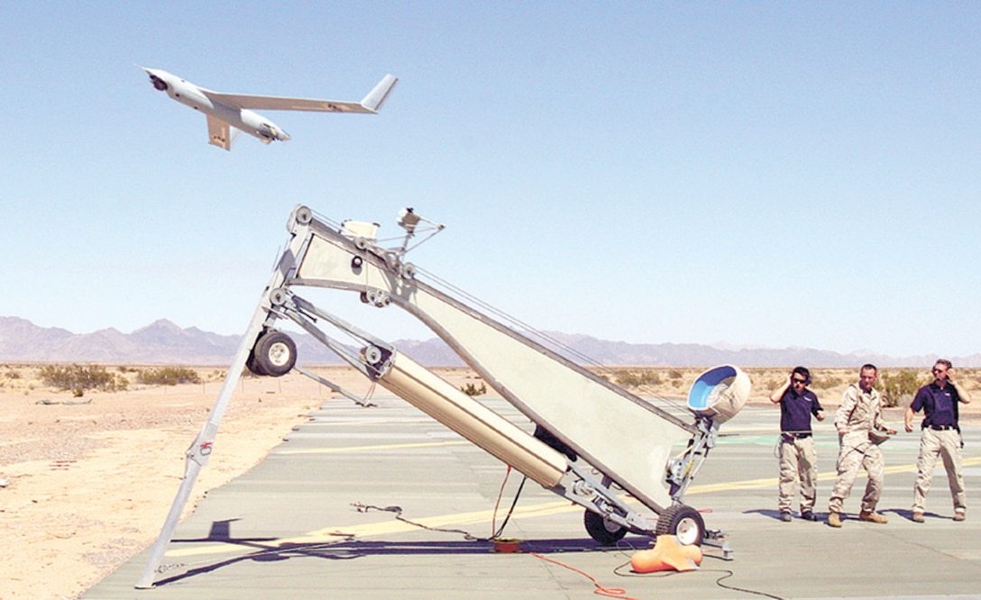 Sgt. Michael Kropiewnicki, U.S. Marine Corp combat videographer, launched a Scan Eagle unmanned aerial vehicle during an exercise at Yuma, Ariz., in 2006. The 820th Security Forces Group will begin using Scan Eagle as part of a user evaluation of the Ground Situational Awareness Toolkit in March. (U.S. Marine Corps photo by  by Sgt. Guadalupe Deanda)