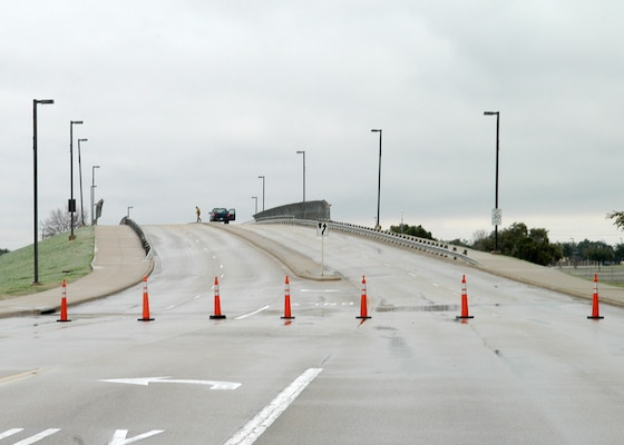 "An ice-slick Truemper Street bridge over Military Drive on Lackland Air Force Base, Texas, is blocked off with cones in this view looking east Jan. 17, 2007. Road conditions such as these existed all across the San Antonio area, resulting in the base closure for all but essential personnel Jan. 16 and 17. ""Safety for Team Lackland was paramount in making the decision to close the base,"" said Brig. Gen. Darrell Jones, then the 37th Training Wing commander. ""We have a lot of dedicated people on this base who wanted to come to work, but I'd rather have them home for a day or two, waiting out the weather, than risk being in an accident."" (USAF photo by Alan Boedeker)"