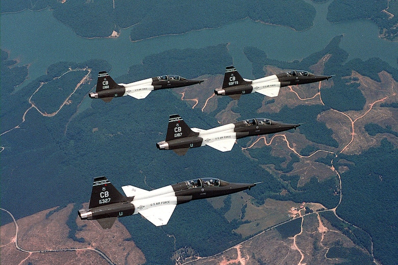 Four T-38 Talons fly in formation. T-38s are twin-engine, high-altitude, supersonic jet trainers used by the 50th Fighter Training Squadron, Columbus Air Force Base, Miss., in a variety of roles because of its design, economy of operations, ease of maintenance, high performance and exceptional safety record. Primarily Air Education and Training Command officials use the aircraft for undergraduate pilot and pilot instructor training. Student pilots fly the T-38 to learn supersonic techniques, aerobatics, formation, night and instrument flying and cross-country navigation. More than 60,000 pilots have earned their wings in the T-38. (U.S. Air Force photo/Senior Airman Matthew C. Simpson)