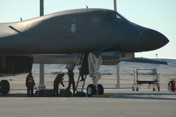 Ellsworth Airmen load a B-1 as the first part of the aviation package prepares to deploy to Southwest Asia. By the end of January, Ellsworth will send more than 400 members in support of the global war on terrorism. (U.S. Air Force photo/Airman 1st Class Kimberly Moore Limrick)