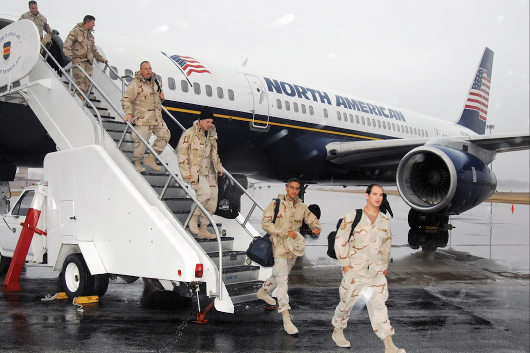 Members of the 55th Wing arrive home to Offutt Dec. 20 in time for the holidays after being deployed to Southwest Asia in support of the war on terrorism. U.S. Air Force Photo by Josh Plueger