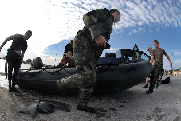 Pararescuemen from the 31st Rescue Squadron on Kadena Air Base, Japan, carry a F470 Zodiac boat from the water used to pick up fellow pararescuemen Jan. 16.  (U.S. Air Force photo/Airman 1st Class Kelly Timney)