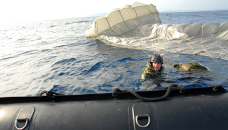 Capt. J. Harman from the 31st Rescue Squadron, Kadena Air Base, Japan, swims to the edge of a F470 Zodiac boat after jumping into the warm, blue waters of Okinawa during a weekly training exercise Jan. 16, at the White Beach Naval facility.  Pararescuemen participate in their weekly proficiency jump which keeps members current in the proper procedures of rescue and keeps them mission ready.  (U.S. Air Force photo/ Airman 1st Class Kelly Timney)