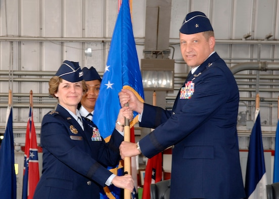 Brig. Gen. David W. Eidsaune receives the Air Armament Center flag of command from Lt. Gen. Terry Gabreski, Air Force Materiel Command vice commander Jan. 12, during the change of command ceremony in Hangar 102.