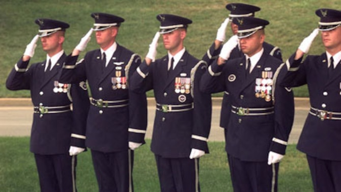 MISAWA AB, Japan -- (from left to right) Staff Sgts. Peter Patrick, Timothy Carney, David Busby, Ruben Gonzales, Anthony Thomas salute as the colors pass during the Air Force honor guard change of command ceremony on June 28, 1999.