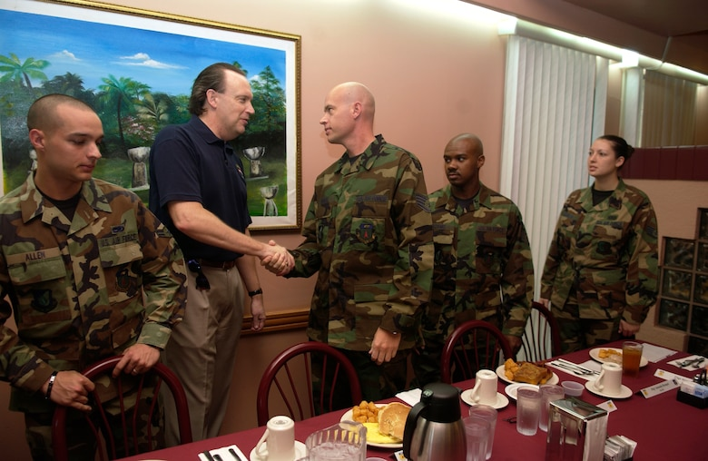 William C. Anderson shares breakfast with several Airmen Jan. 20 during his visit to Andersen Air Force Base, Guam. As assistant secretary of the Air Force, Mr. Anderson heads three division departments that deal at the policy level with Air Force facility and logistical issues. The department's responsibilities include installations, military construction, base closure and realignment; environment, safety and occupational health issues; and all logistical matters. (U.S. Air Force photo/Senior Airman Miranda Moorer)