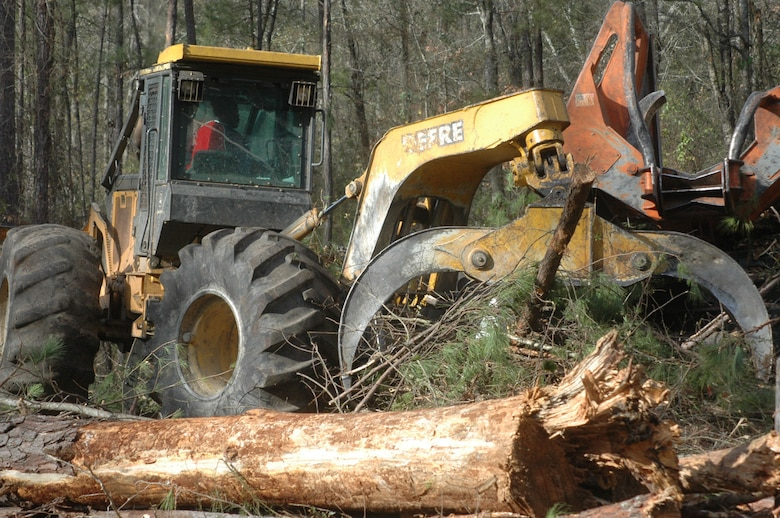 An area on the south end of Robins Air Force Base is designated as a Longleaf pine reforestation site. A skidder drags downed trees to be loaded and picks up debris. (U.S. Air Force photo by Sue Sapp)