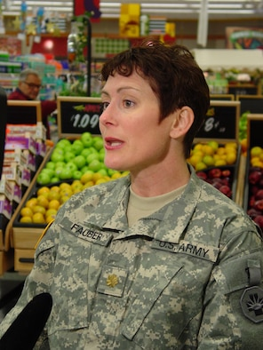 Maj. Karen Fauber, the DeCA dietitian, is shown here at the Andrews Air Force Base Md. Commissary during the filming of a segment for the Pentagon Channel. The segment, scheduled for release in the near future, will offer advice on how to shop for foods that will help consumers stick to their New Year's resolutions to lose weight.