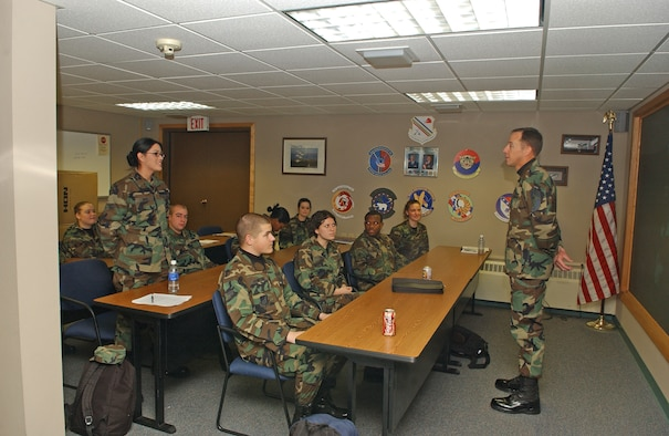 EIELSON AIR FORCE BASE, Alaska--Chief Master Sgt. Anthony Bishop, Pacific Air Forces command chief speaks with first-term Airman, Airman Claudia Arcie about her top three reasons why she joined the Air Force at the First-Term Airman's Center during his visit to Eielson Jan. 17 and 18. (U.S. Air Force Photo by Senior Airman Anthony Nelson)