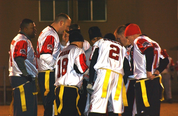 OSAN AIR BASE, Republic of Korea --  The 5th Reconnaissance Squadron's intramural flag football team huddles to prepare for the next play. (U.S. Air Force photo by Senior Airman Eunique Stevens)