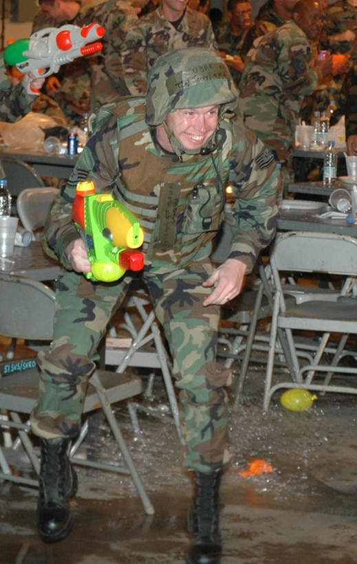 OSAN AIR BASE, Republic of Korea --  Tech. Sgt. Jerol Boyce, 51st Fighter Wing legal office, dodges a stray balloon thrown at someone running the obstacle course. The Osan 5/6 Club hosted the first Team Osan 'Enlisted Only' Combat Dining-In Saturday at the traffic management office warehouse in Bldg 635. (U.S. Air Force photo by Tech. Sgt. Michael O'Connor)