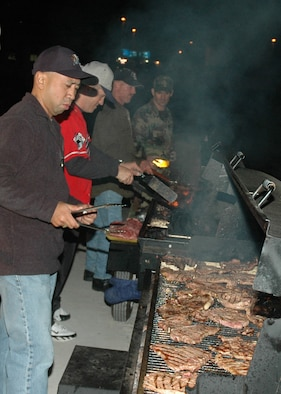 OSAN AIR BASE, Republic of Korea --  The Osan 5/6 Club hosted the first Team Osan 'Enlisted Only' Combat Dining-In Nov. 30 at the traffic management office warehouse in Bldg 635. Approximately 12 people were responsible for preparing, cooking and serving more than 600 pieces of steak and chicken. (U.S. Air Force photo by Tech. Sgt. Michael O'Connor)