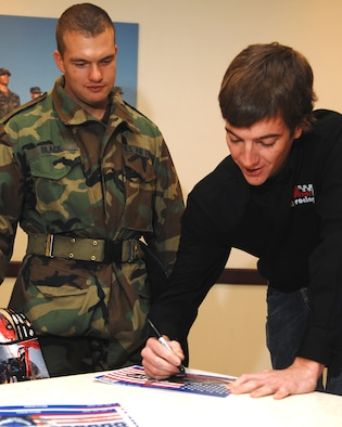 LACKLAND AFB, Texas -- Jon Wood, right, new driver of the Air Force-sponsored NASCAR No. 21, signs an autograph for basic trainee Airman Basic Black during an Air Force basic military training orientation tour Jan. 16, 2007, on Lackland Air Force Base, Texas. Sponsorship of NASCAR No. 21 promotes Air Force awareness by providing a venue to share career opportunities with men and women ages 17-27, the Air Force's main recruiting demographic. (U.S. Air Force photo by Master Sgt. Scott Reed)