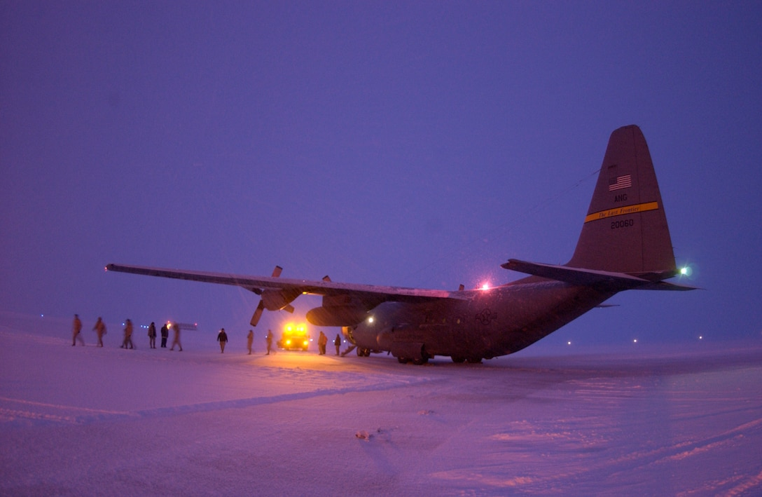 """On their way home from Bagram, Afghanistan, Airmen from the Kulis Air National Guard Base, Alaska, exit their C-130 Hercules during a """"gas and go"""" stop Jan. 25 at Thule Air Base, Greenland.  (U.S. Air Force photo/Michael Tolzmann)"""