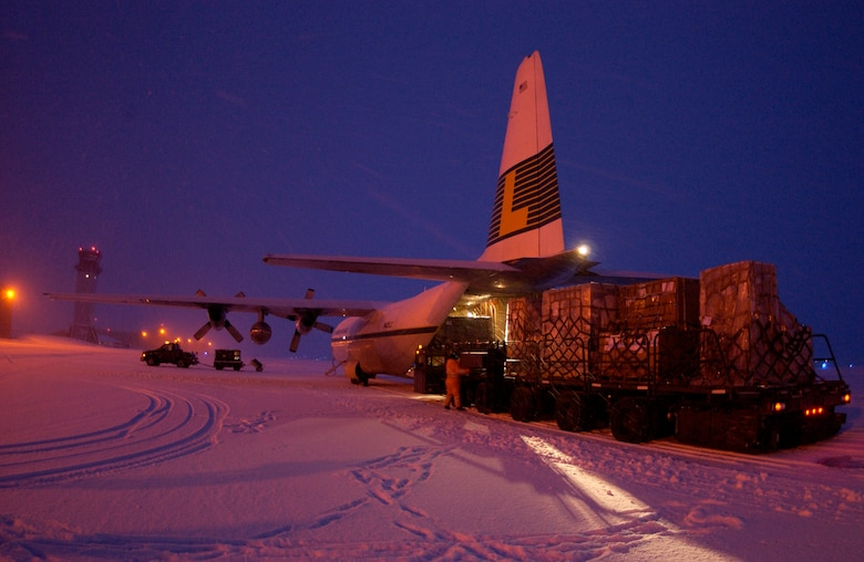 Airmen unload supplies for the base Jan. 25 at Thule Air Base, Greenland. The supplies are flown in on a weekly contracted L-100 aircraft from McGuire Air Force Base, N.J.  (U.S. Air Force photo/Michael Tolzmann)