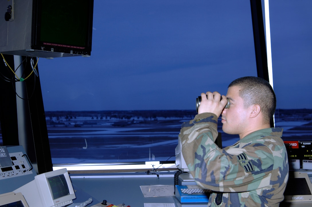 Senior Airman Briant Bell, 22nd Operation Support Squadron air traffic controller, works the air traffic control tower Jan. 18. Air traffic controllers here monitor aircraft in order to prevent accidents. They direct the movement of aircraft into and out of McConnell's airfield. They track aircraft by radar and relay information to aircrews via radio. They relay flight and landing instructions, weather reports and safety information to pilots.