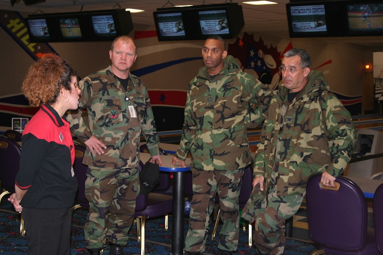 (Left to right) Danielle Garcia, bowling center employee, gives a tour of the Hill Bowling Center to Senior Master Sgt. Wade Clark, 75th Services Division superintendent, Chief Master Sgt. Venton Lamont, AF LeMay team member  and Col. Frederic Ryder, AF LeMay team chief, during a visit last week to evaluate the entire services division as part of the Gen. Curtis E. LeMay competition. This competition is used to select the best services program in the Air Force.