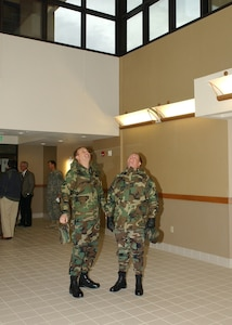 Lt. Col. Mike Kelly (left), deputy commander of the 37th Training Group at Lackland Air Force Base, Texas, and Col. Eric Beene, commander of the 37th Mission Support Group, look up and admire the atrium view from the ground floor of a new three-story dormitory for 600 security forces students during a walk-through following the building dedication Jan. 24. (USAF photo by Alan Boedeker)