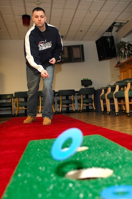Staff Sgt. Phil Pelletier, Hanscom Patriot Honor Guard, hones his washer throwing skill during the recent Washers Tournament practice at the Minuteman Club. Washers is an indoor and outdoor game that is played and scored similarly to horseshoes. The first quarterly tournament will be held at 4:30 p.m. on Feb. 2, during Member's Night at the Minuteman Club. Team registration is required, call (781) 377-9939 for more information. (US Air Force Photo by Mark Wyatt)