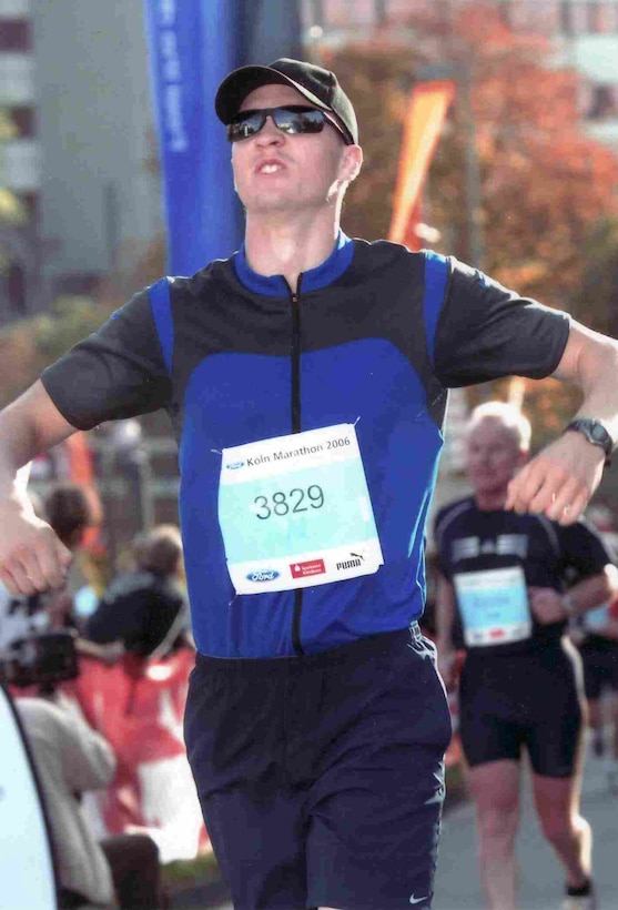 COLOGNE, GERMANY -- Lawrence Herstel savors crossing the Cologne Marathon finish line after nearly a year of training. (Courtesy photo)