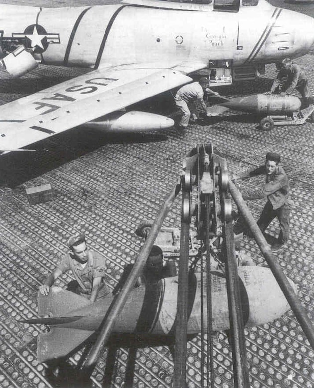 Loading bombs on an F-86.