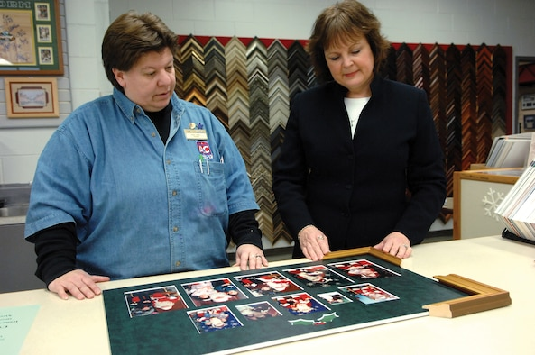 MCCHORD AIR FORCE BASE, Wash.-- Patty Valdez, 62nd Services Squadron, left, discusses projects with sales representative Darcy Beleny Jan. 18 in the arts and crafts frame shop. (U.S. Air Force Photo/Abner Guzman)
