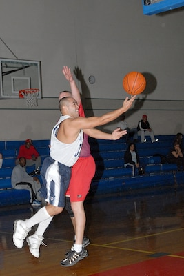 Armando Daniel for the 342nd Training Squadron at Lackland Air Force Base, Texas, balances the ball against Tom Roomsburg from Radiology, the 759th Diagnostics and Therapeutics Squadron, Jan. 26 at the Chaparral Fitness Center. (USAF photo by Robbin Cresswell)